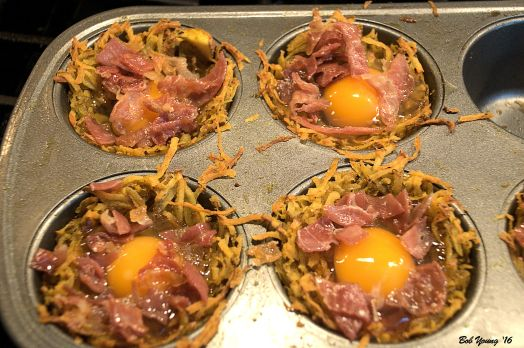 Eggs are placed in the cups and baked for about 20 minutes until the whites are set.