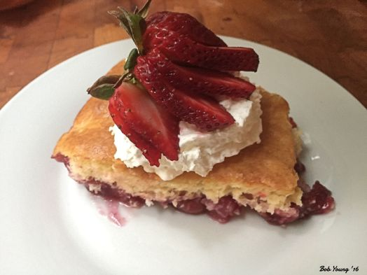 Dump Cake with trawberry fan on whipped cream
