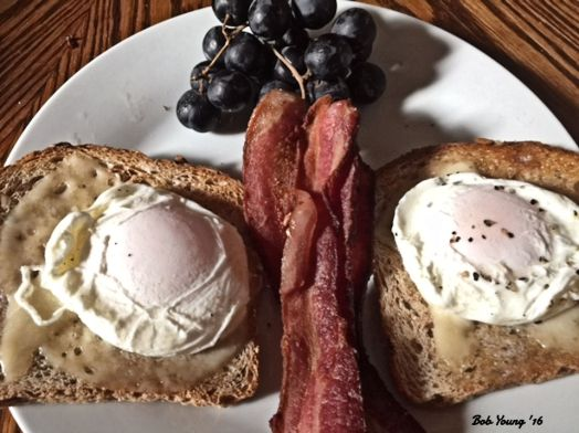 Poached Eggs on Acme Bakeshop Seed Toast Baby Swiss Cheese Bacon Black Grapes