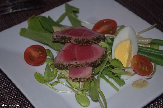 Nicoise Salad arugula, sunflower sprouts, herbs de Provence, seared tuna, haricots verts, egg, Kalamata olives dressing, tomato 2013 Selection Laurence Feraud Cotes du Rhone
