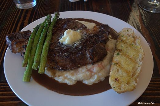 One-Inch Cut Char-Grilled Ribeye Steak - $16.95 Topped with Bleu Cheese Butter and accompanied by Rosemary Truffle Mashed Potatoes with Cabernet Beef Demi-Glace, Grilled Asparagus and Storm's Homemade Grilled Bread