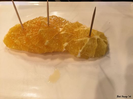 Orange slices to counter the spiciness.