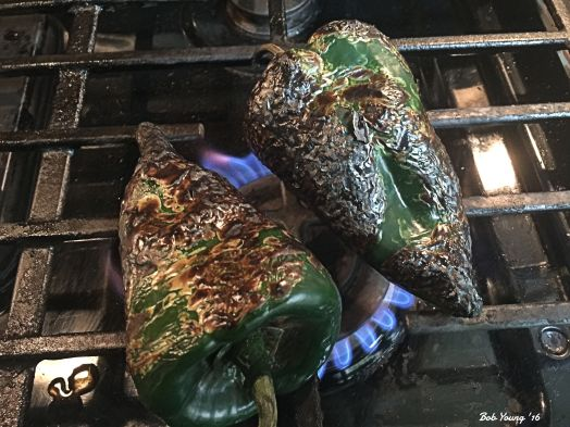 Roasting the poblanos on the gas stove.