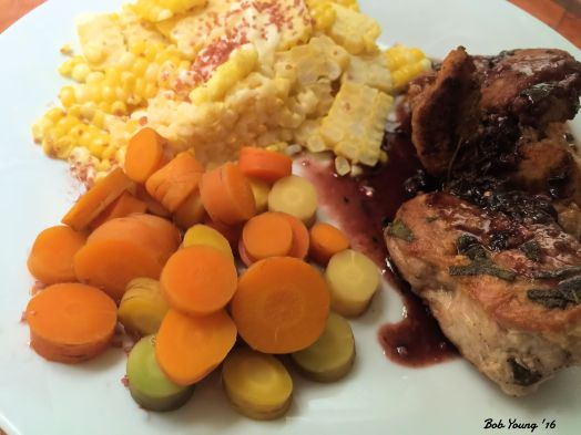 Heirloom Carrots, Fresh Corn Pork medallions with Port Wine and Herb Reduction