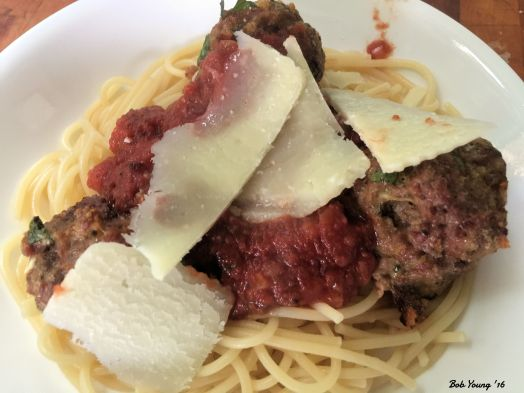 The plated dinner of Spaghetti, Meatballs and Marinara with Shaved Pecorino