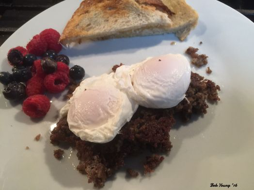 Crumble Scrapple with Meadowlard Farms Poached Eggs Acme Bakeshop Toasted Sourdough Fresh Raspberries and Blueberries