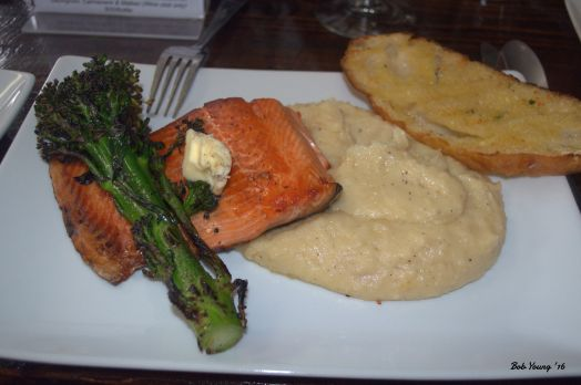 Storm's Famous Salmon - $16.95 Brined, Lightly Smoked and Pan Fried with Rosemary Truffle Butter and Rosemary Truffle Mashed Potatoes accompanied by Grilled Asparagus Storm's Homemade Grilled Bread