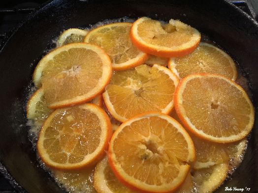Caramelizing the orange slices. I use a mandolin to get the thin slices.
