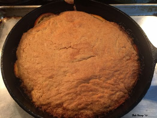 The cake is cooked and is now cooling before removing it from the skillet.